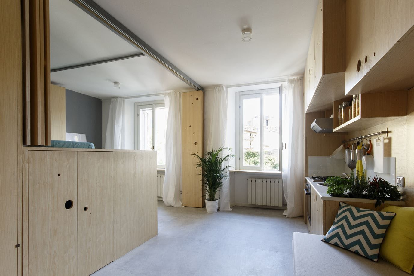 Small Studio Apartment With A Clever Movable Partition System Idesignarch Interior Design Architecture Interior Decorating Emagazine Apartment Interior Apartment Interior Design Tiny Living Italy small bedroom apartment
