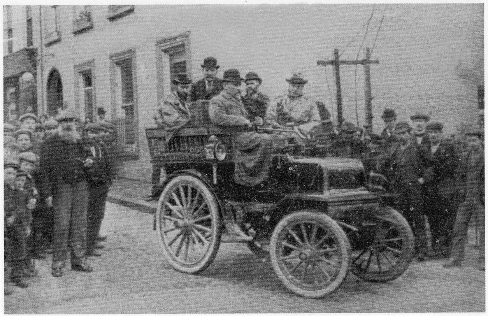 The car is a 1897 Daimler Stirling, one of the first \
