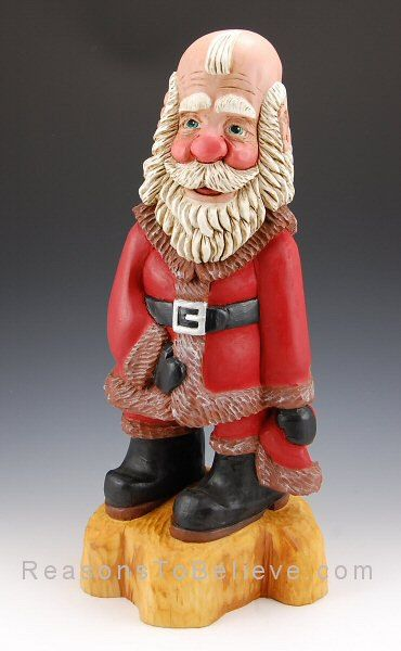 Santa Claus holding his hat, revealing cute balding head. Hand carved and hand painted cypress knee (solid wood) Santa Claus by Paul Green. Tall, unique, masterfully designed Santa carving and full of character.