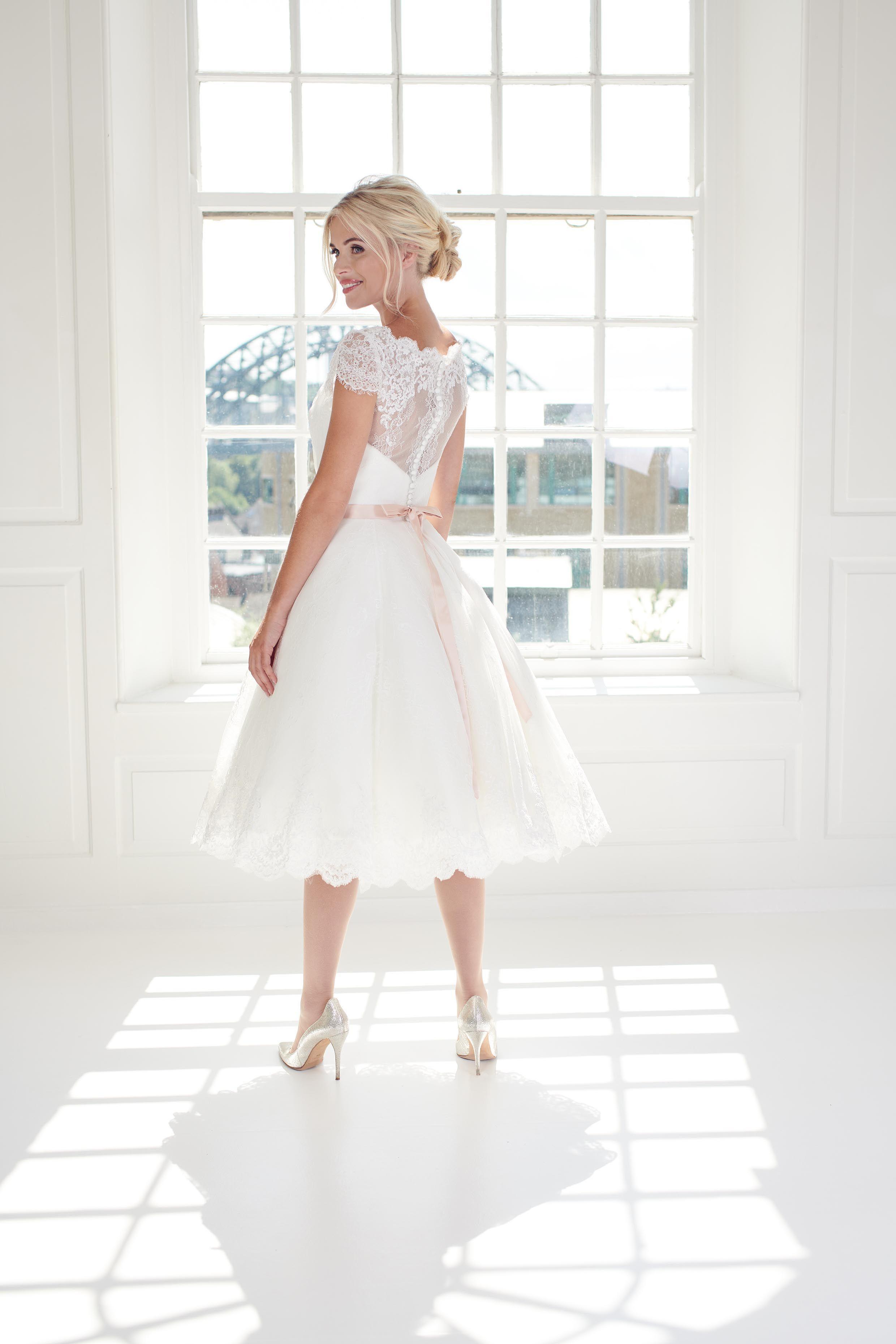 Elegant vintage 1950's short tea length wedding dress with