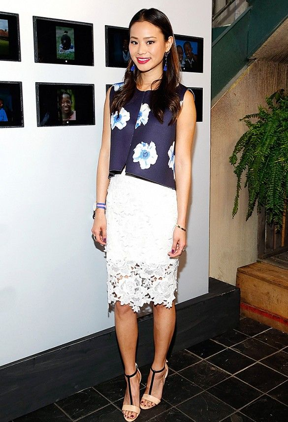 bd96782327b5ce Jamie Chung wears a white lace pencil skirt with a floral-printed top.      OutfitIdeas