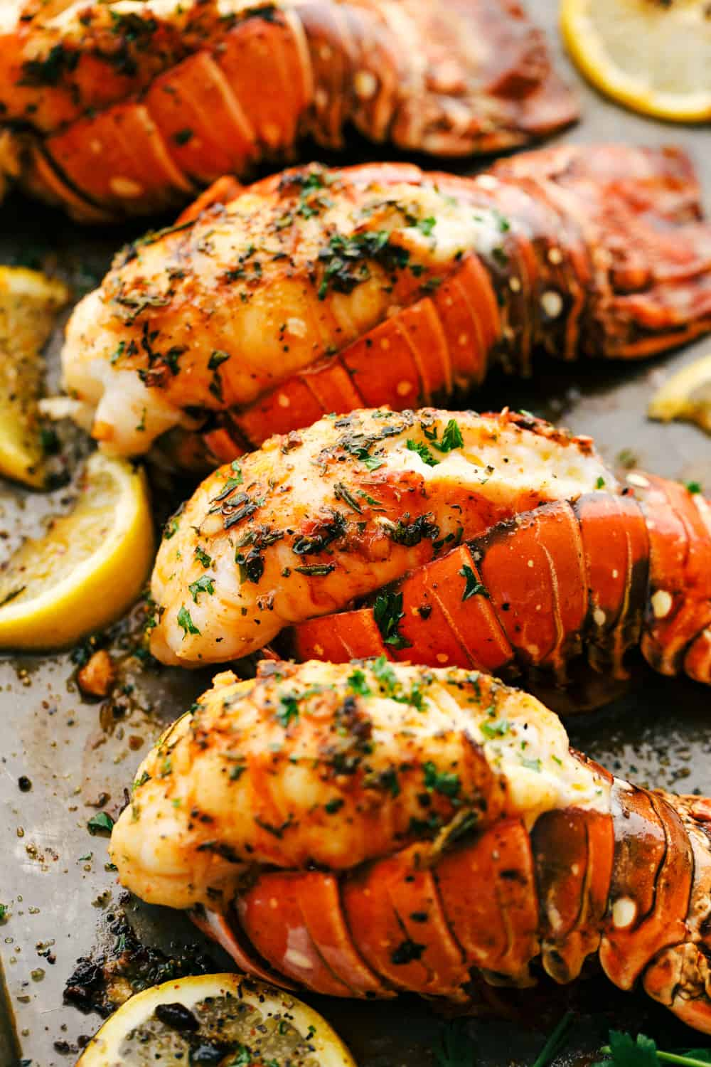 The Best Lobster Tail Recipe Ever is a decadent dinner made with large lobster tails smothered with a buttery garlic herb sauce then broiledunder high heat making these lobster tails tender and juicy. The ultimateindulgence!