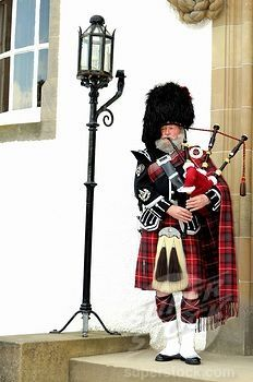 Bagpiper Wearing A Traditional Scottish Costume With A Bear Skin Hat And Kilt Scottish Fashion Scottish Costume Scottish Bagpipes