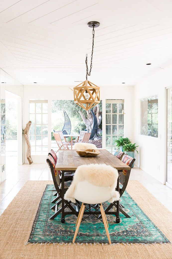 Bright Boho Dining Room With A Farm Style Table And A Rattan Pendant Light