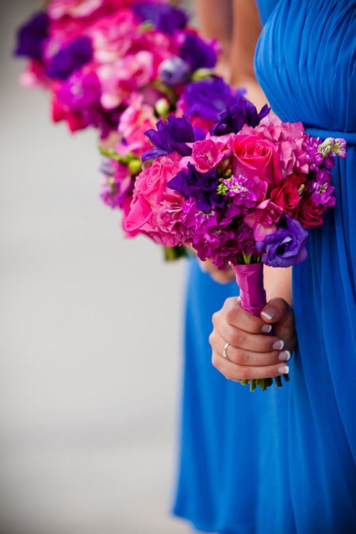 Very Nice Petite Bridesmaid Bouquets Made With Vibrant Pink Fuchsia And Purple Look Great Against The Blue Dresses