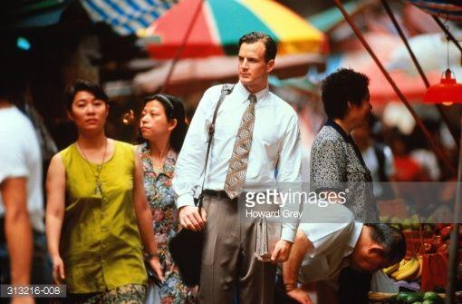 Stock Photo : Male executive walking through busy market, Hong Kong
