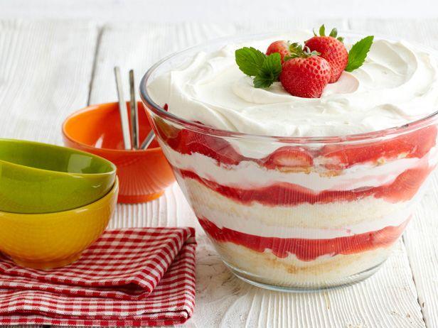 OH MY!! Paula Deen's Strawberry Shortcake...angel food cake layered with custard (cream cheese, sweetened condensed milk & whipped topping) and berries w/glaze of sugar, cornstarch, water & strawberry gelatin.