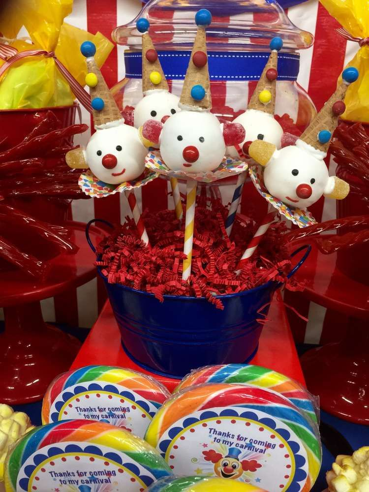 Fun clown cake pops at a carnival birthday party! See more party ideas at CatchMyParty.com!