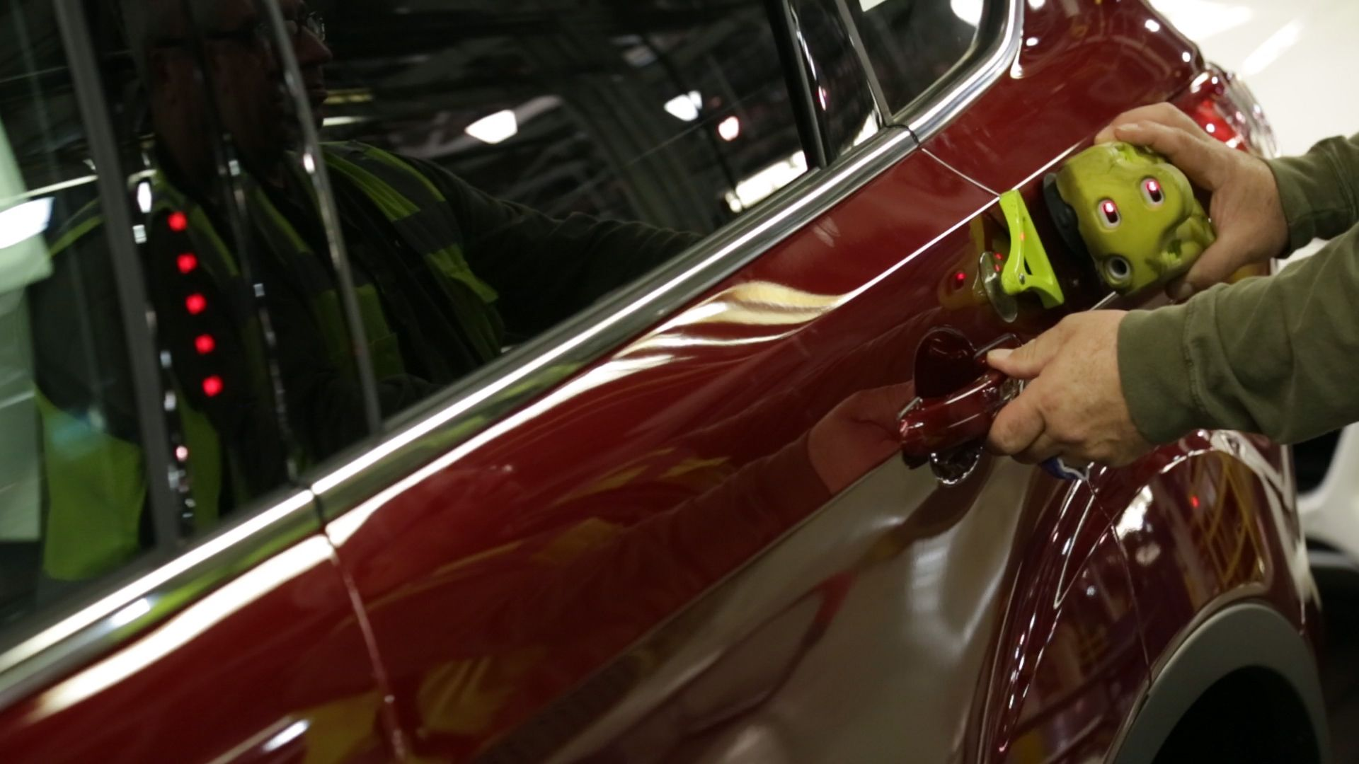 Louisville Assembly Plant, March 18, 2016-- To ensure that closing a door on Escape is consistently effortless, a worker applies suction cup-backed sensors to either side of a door opening, then closes the door by hand to get a velocity reading, which calculates the amount of effort required. Once it's verified the amount of effort does not exceed the Ford standard, the tools are quickly moved to the next door for another test. Customer benefit is that minimum effort is required to close…