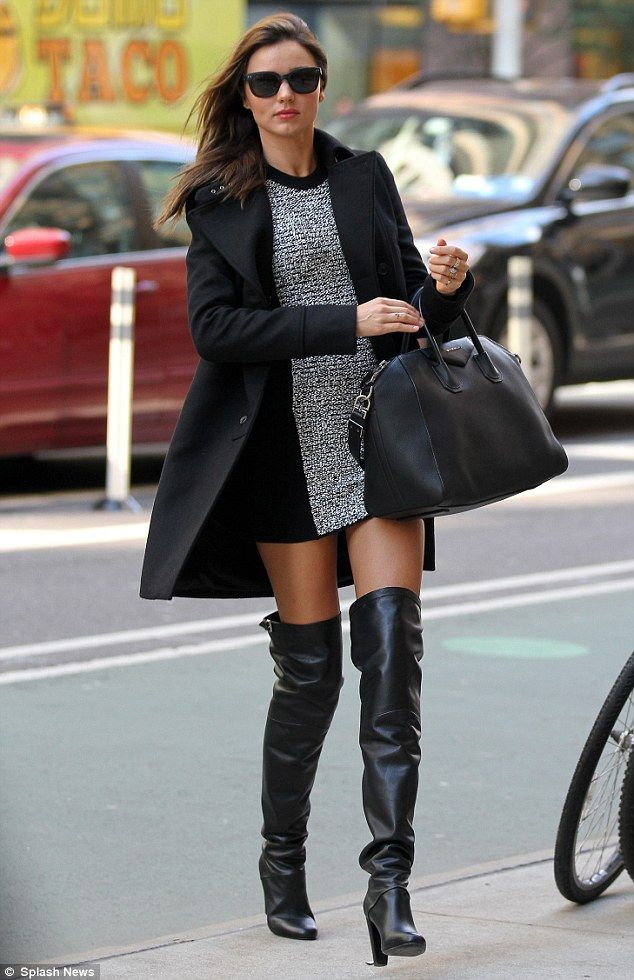 a489751d6ea Model Miranda Kerr highlights her long legs in thigh high boots as she  arrives for a day at work shooting the new Victoria s Secret campaign on  Monday ...