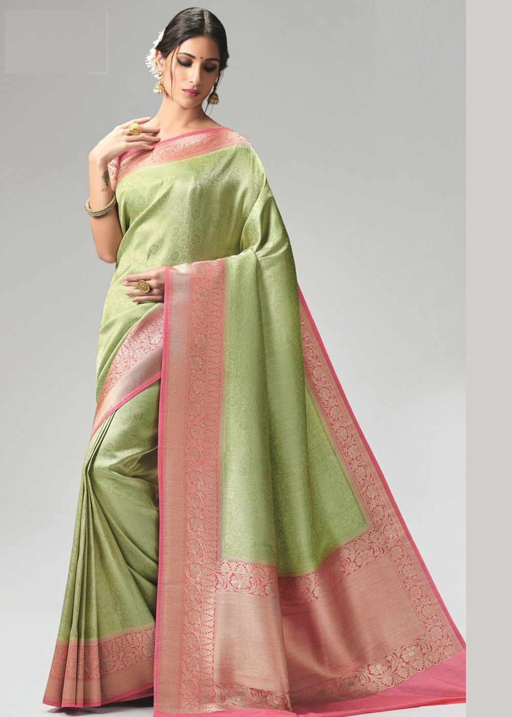 6e86c320f5 Light green art #silk #saree in all over woven work, pink border and  distinctive pallu design. Accompanied by a pink blouse piece in art silk as  well.