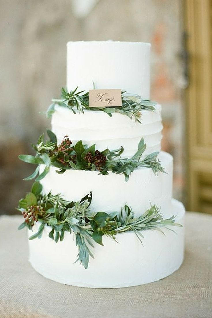 Rustic Greenery Four Tiered Wedding Cake Winter Pinecones Evergreen Dusty Miller