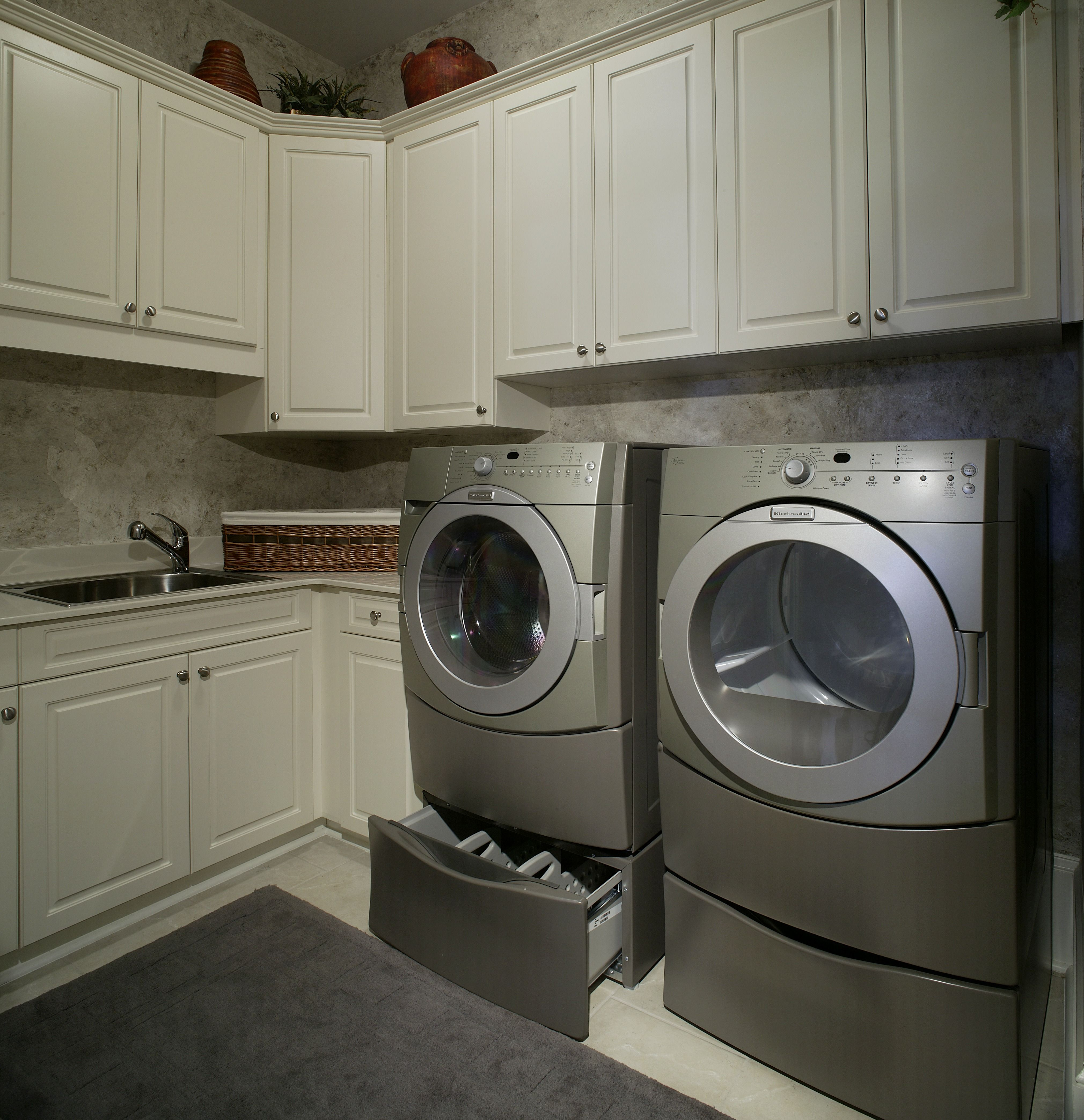 Cabinet Refacing Cost: A Clean Look With White Cabinets And A Gray Washer And