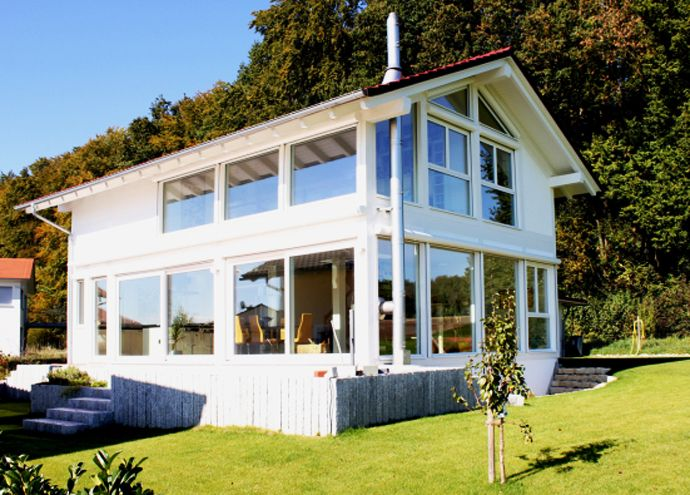 Low Costs Building In A Prefabricated Wooden House From Germany