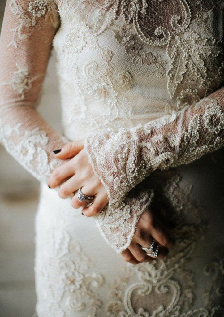 Pearle lace wedding gown by Claire Pettibone beaded with pearls and rose gold.