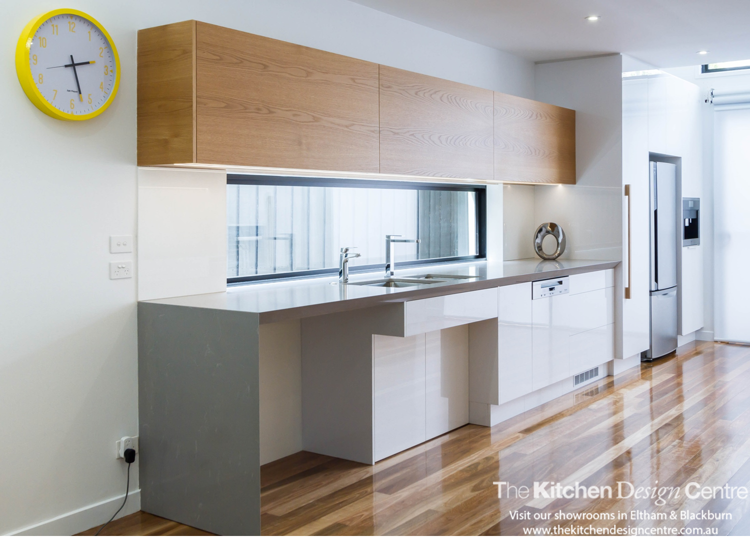 a modern wheelchair accessible kitchen featuring high gloss doors a modern wheelchair accessible kitchen featuring high gloss doors timber veneer and quantum quartz