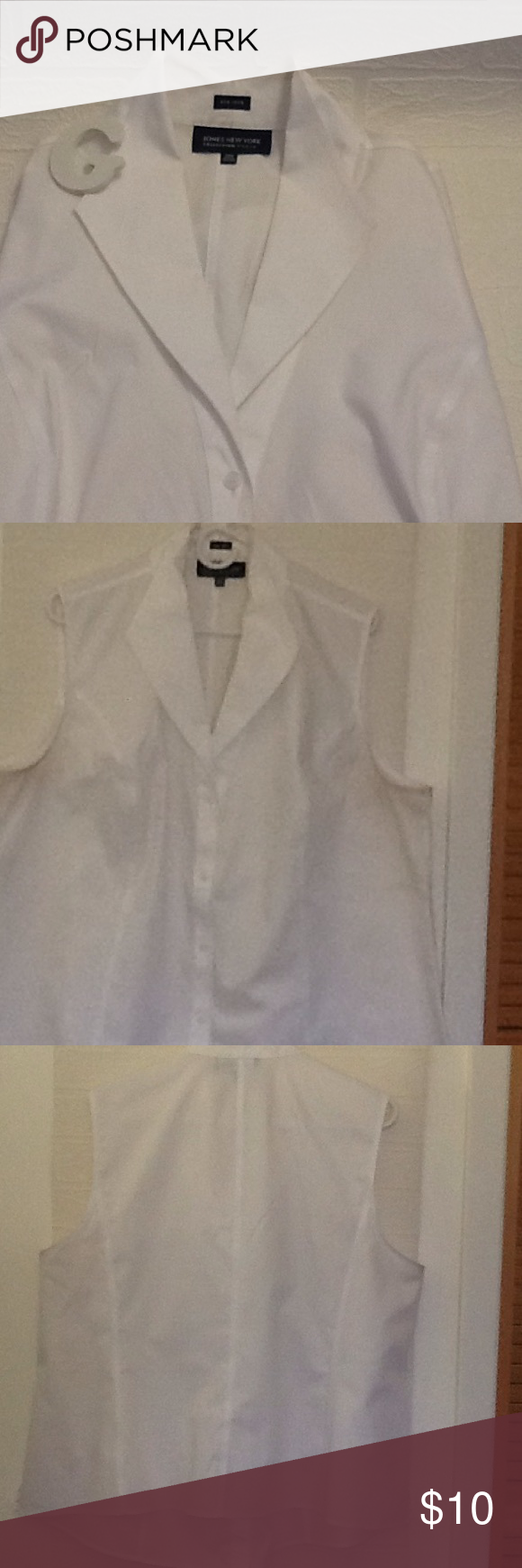 Used for work jones New York collection woman White button down sleeveless shirt, usage on neck, still has a lot of life. Jones New York Tops