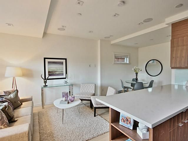 #Homestaging Tips 1) Add some texture i.e. rug 2) Put some welcoming details such as flowers or books on the table | Inside a #townhome @723 Union Street #Vancouver #Canada | www.krynitzki.com http://www.strathconahomesforsale.com