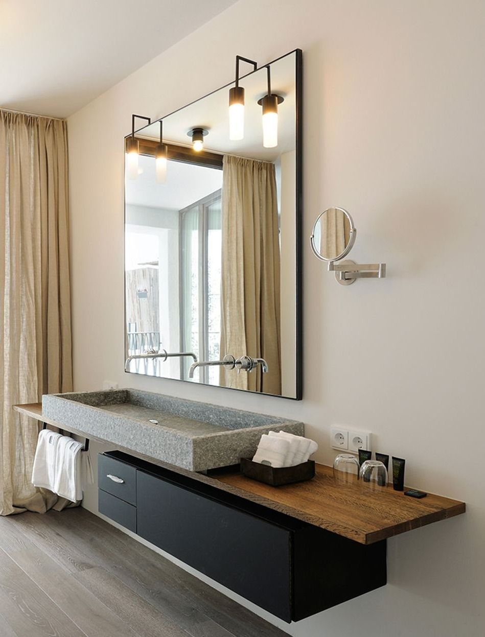 Warm bathroom interior with a solid natural stone sink.