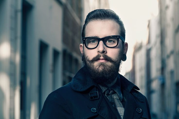 man's portrait.beard, glasses.