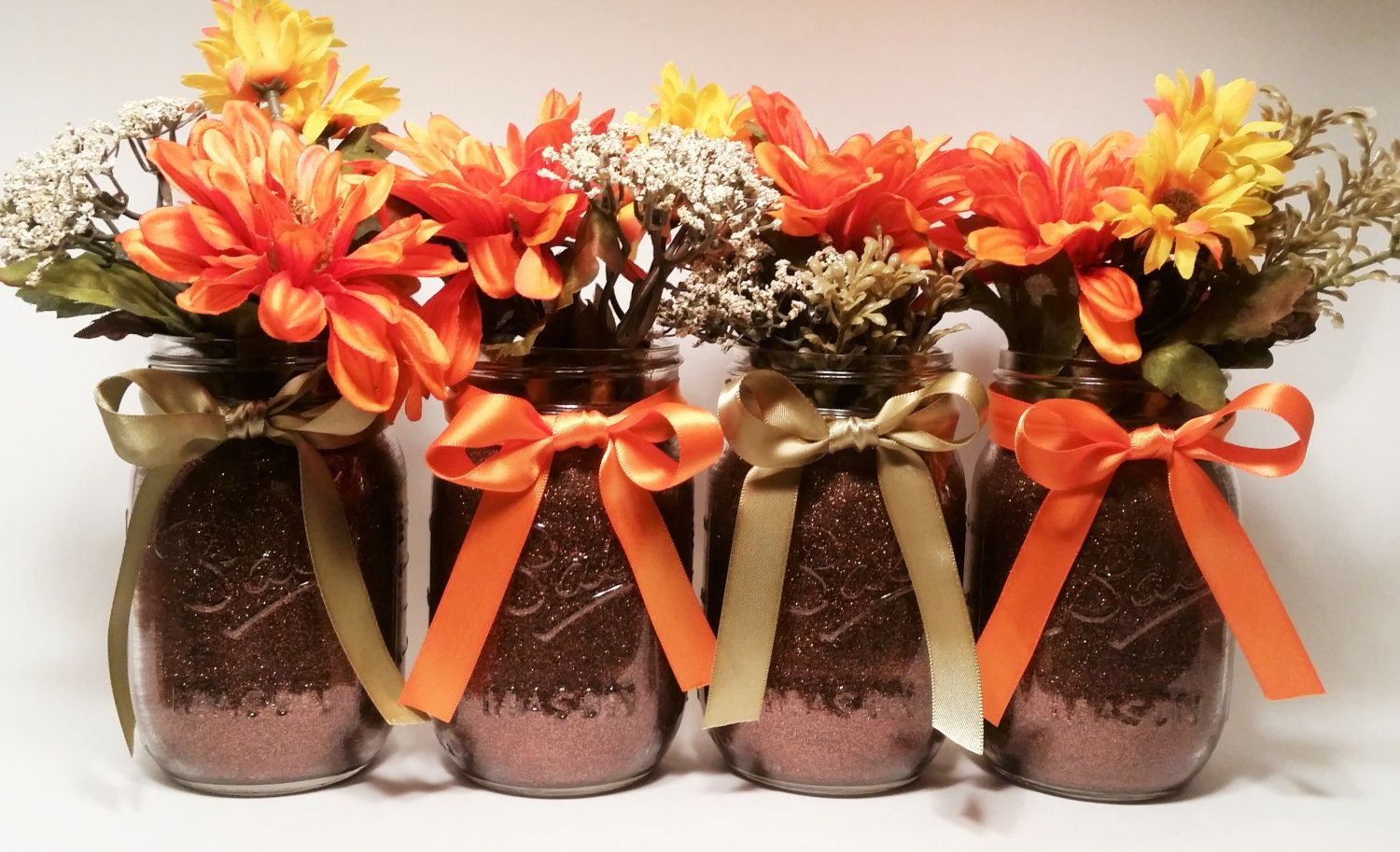 Lovely fall wedding decoration from mason jars that you can create on your own. don't forget to add your ribbons and seasonal fall flowers