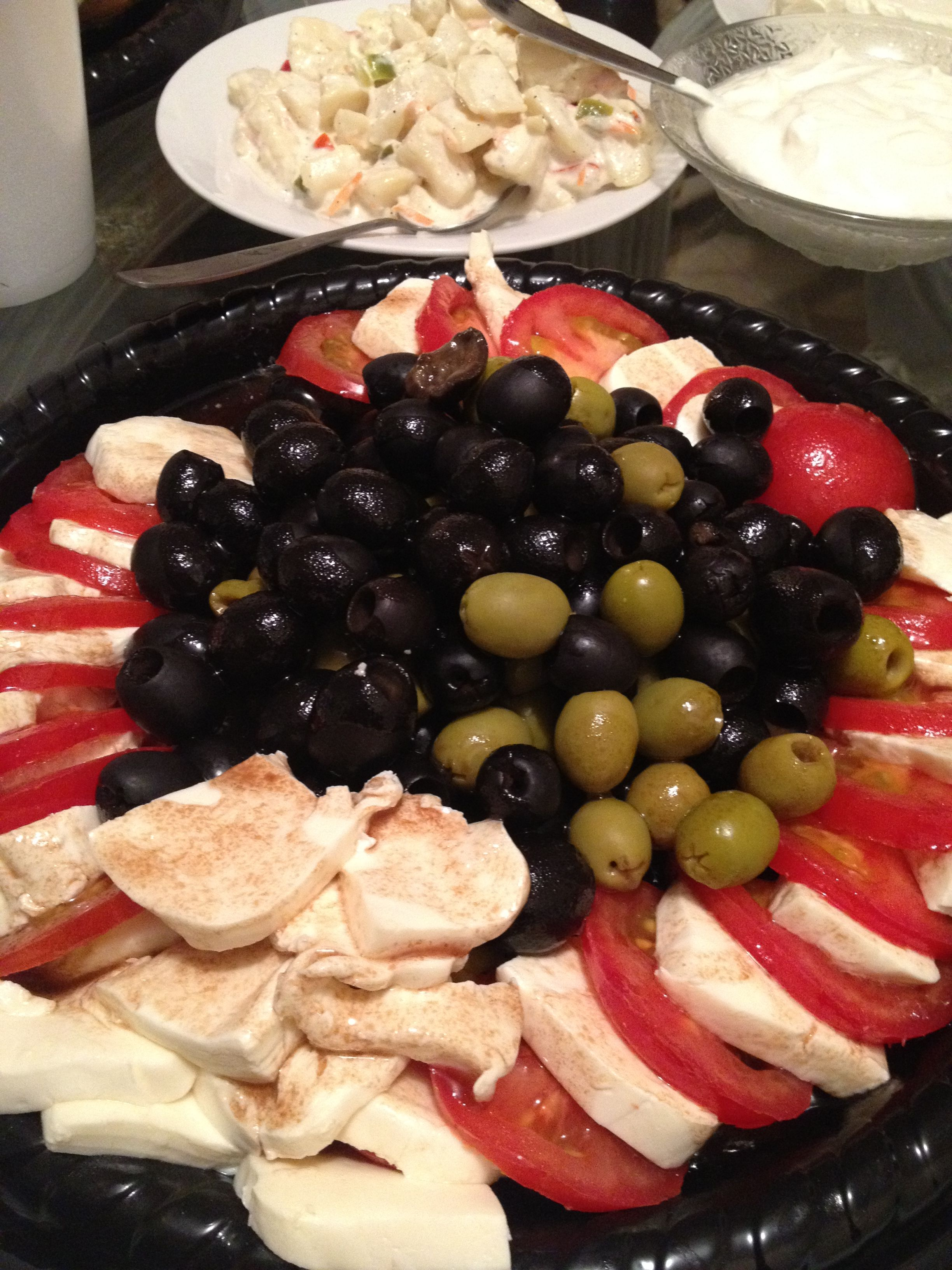 A great party favor for lunch! Mixed olives fresh #mozzarella & tomatoes cut thick topped with #balsamic vinegar!