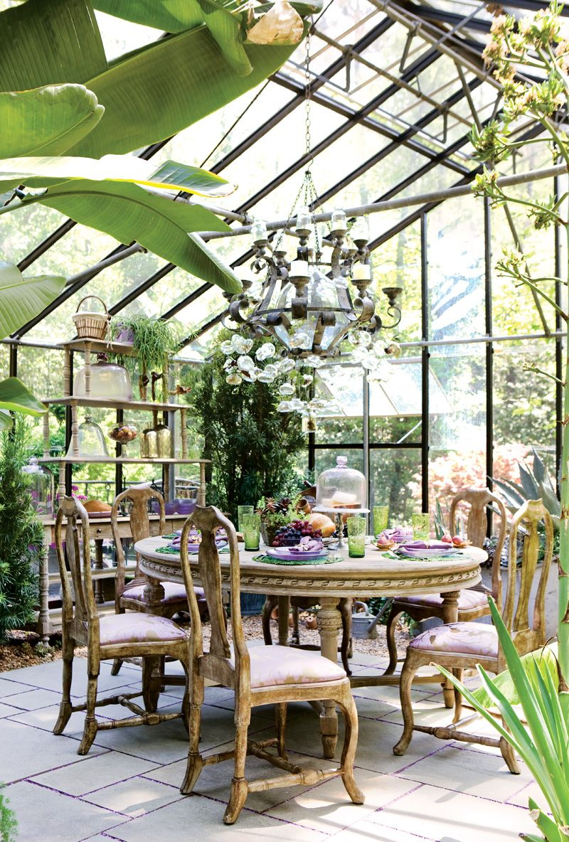 A glass greenhouse turned into a eclectic dining room. just lovely ...