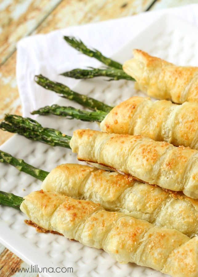 Asparagus wrapped in puff pastry sheets and stuffed with cream cheese. - Thanksgiving.com