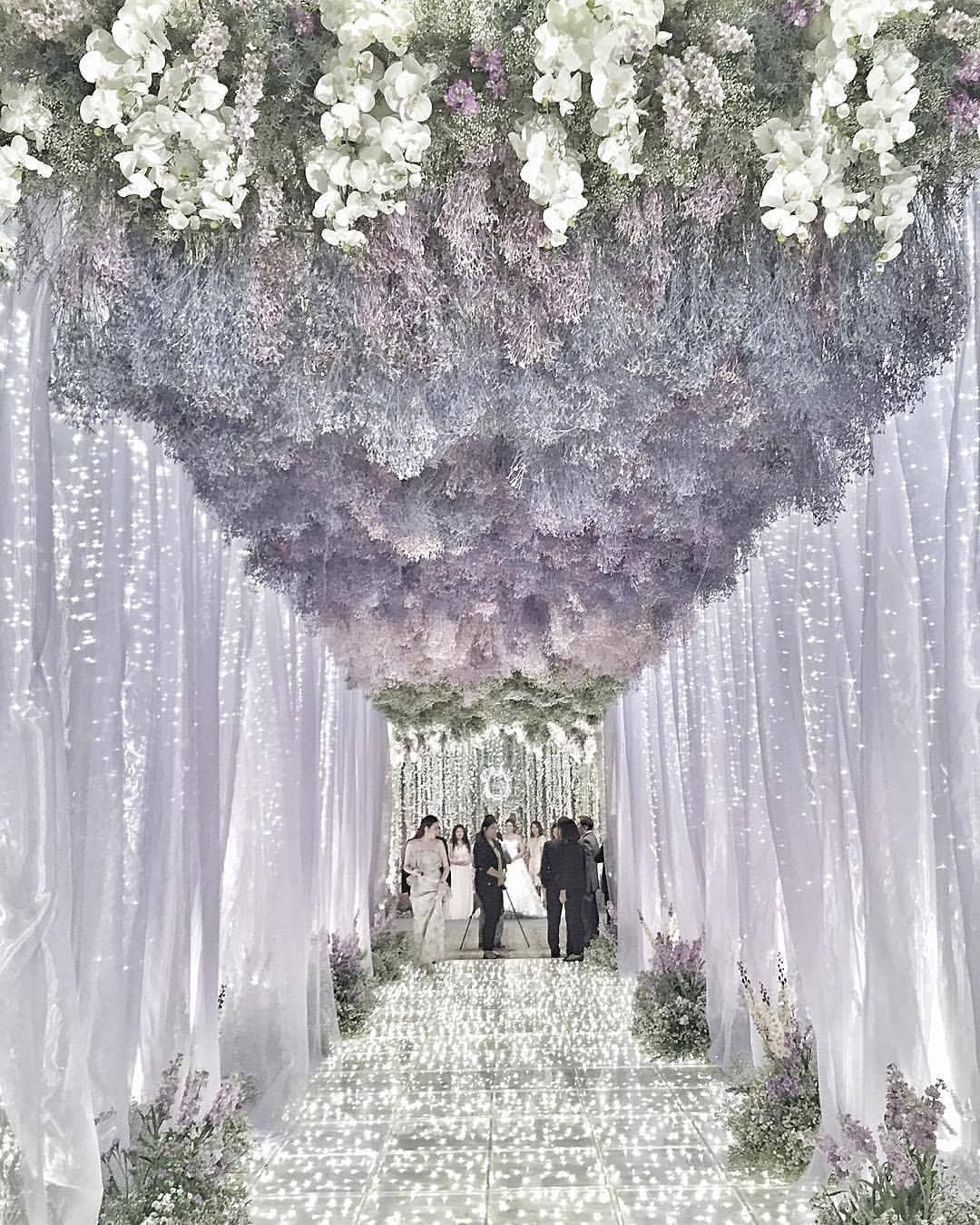 Purple Wedding Inspiration From This Incredible Tunnel With Fairy Lights And A Ceiling Suspended White