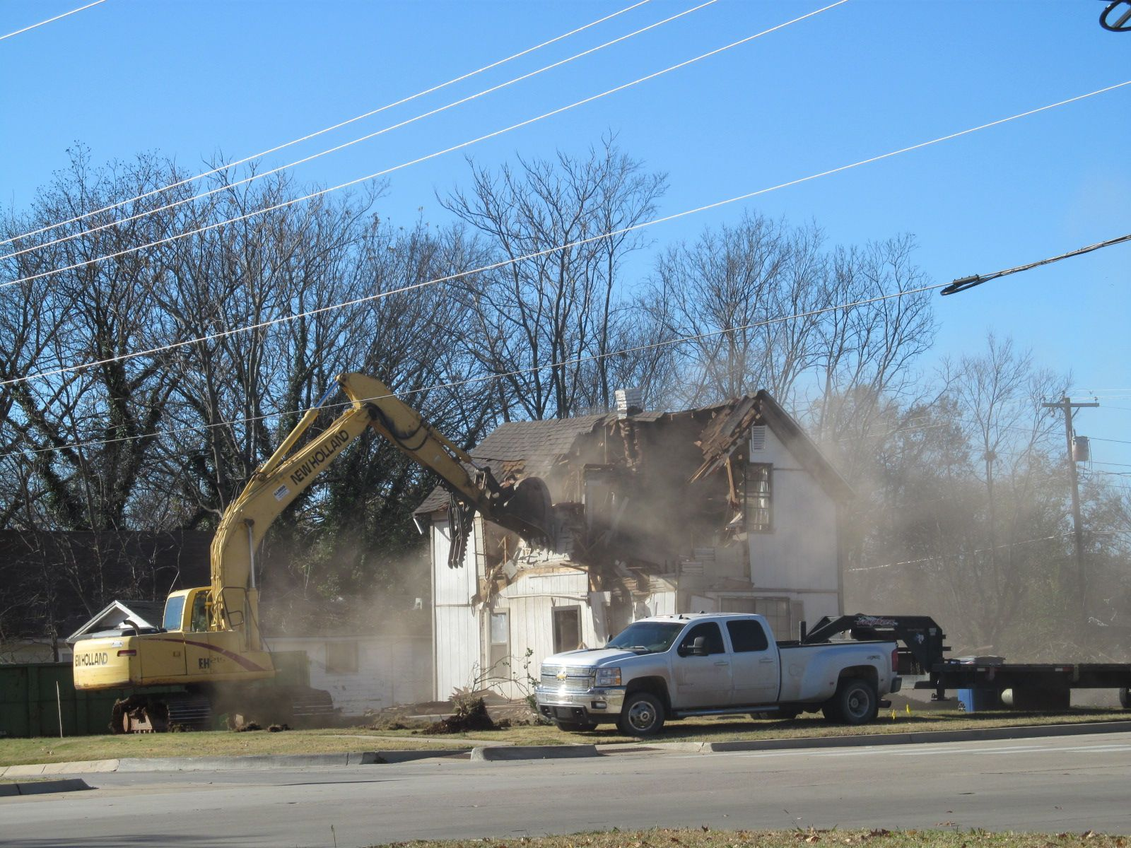 A house being demolished across from the library. Best job in the world!