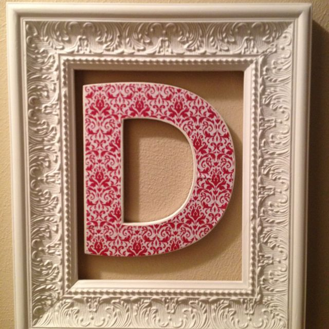 Chipboard letter painted, scrapbook paper modge podged on, hung in an empty frame