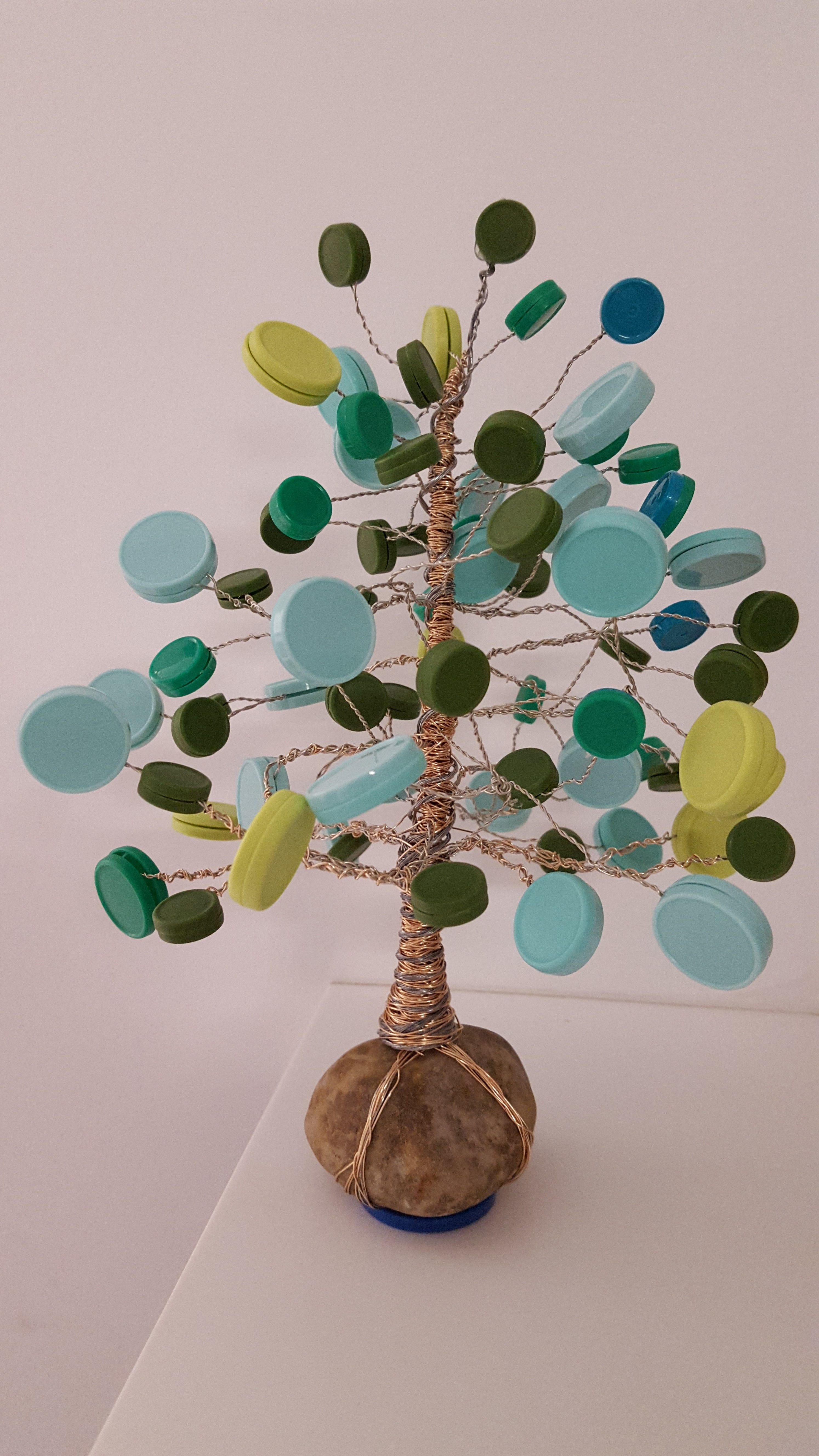 Med cap tree I made for our infusion room :) (made from medication vial caps, hot glue, and wire)