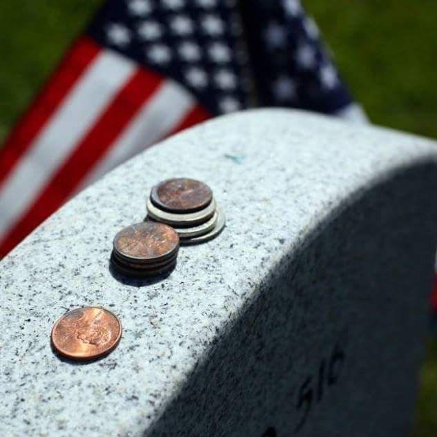coins on tombstones