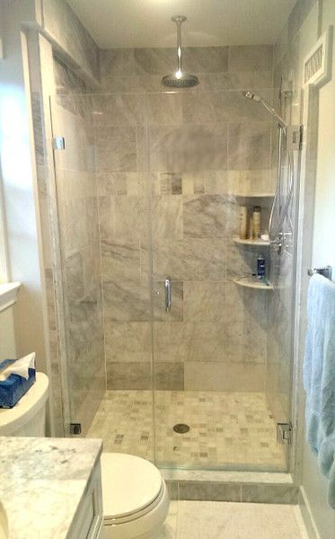 Frameless shower enclosure with a hinged door and fixed panel. This ...