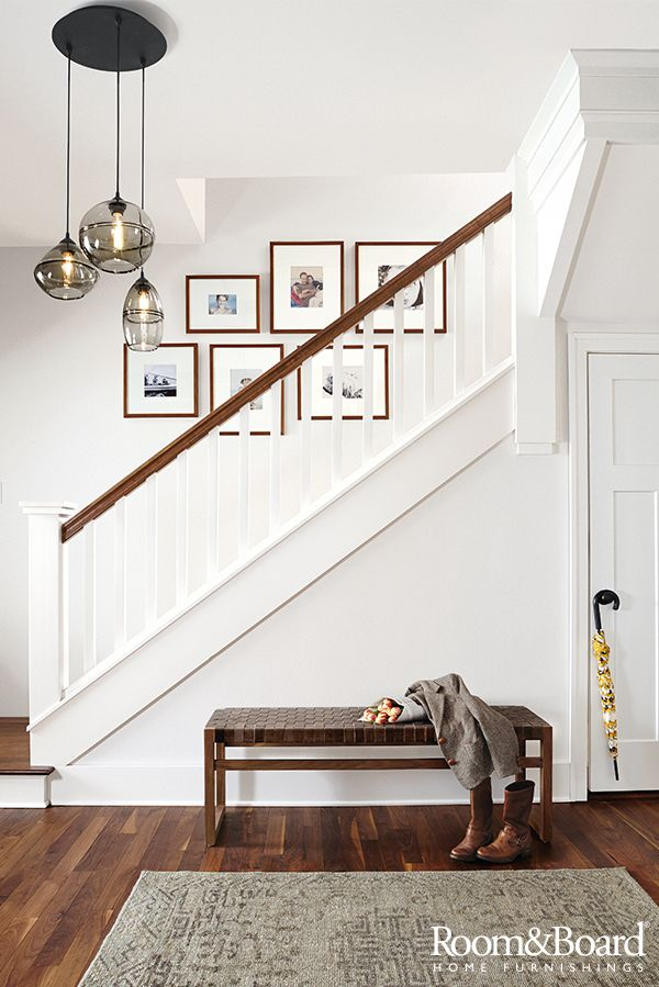Add Seating And Storage To Your Entryway With A Modern Bench Stairway Decorating Home Stairway Gallery Wall