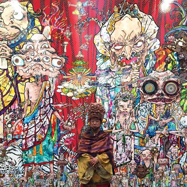 """Takashi Murakami greeting visitors at his new show """"In the Land of the Dead, Stepping on the Tail of a Rainbow"""" at the Gagosian."""