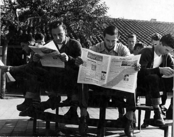 In this 1946 photo, FJC students read the copies of the student newspaper, the…