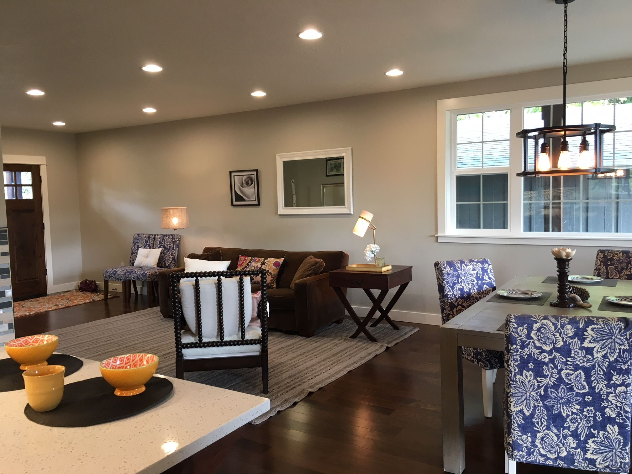 Living room and dining room defined with furniture and ...