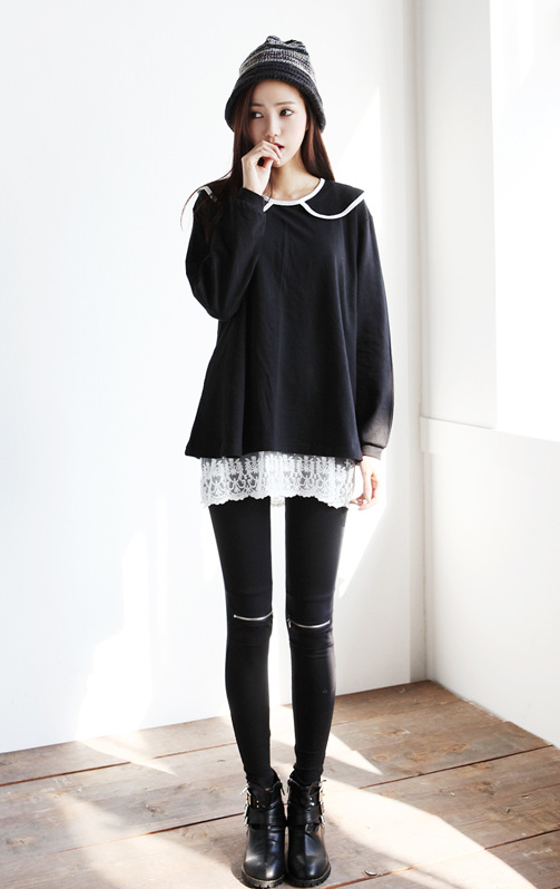 The longer flowy shirt underneath a thing sweater is popular right ...