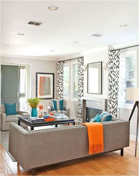 teal accents living room small interiors design new look for the den since we re painting it grey love orange and