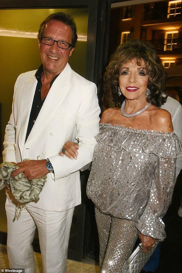 Joan Collins, 86, dazzles in silver alongside husband