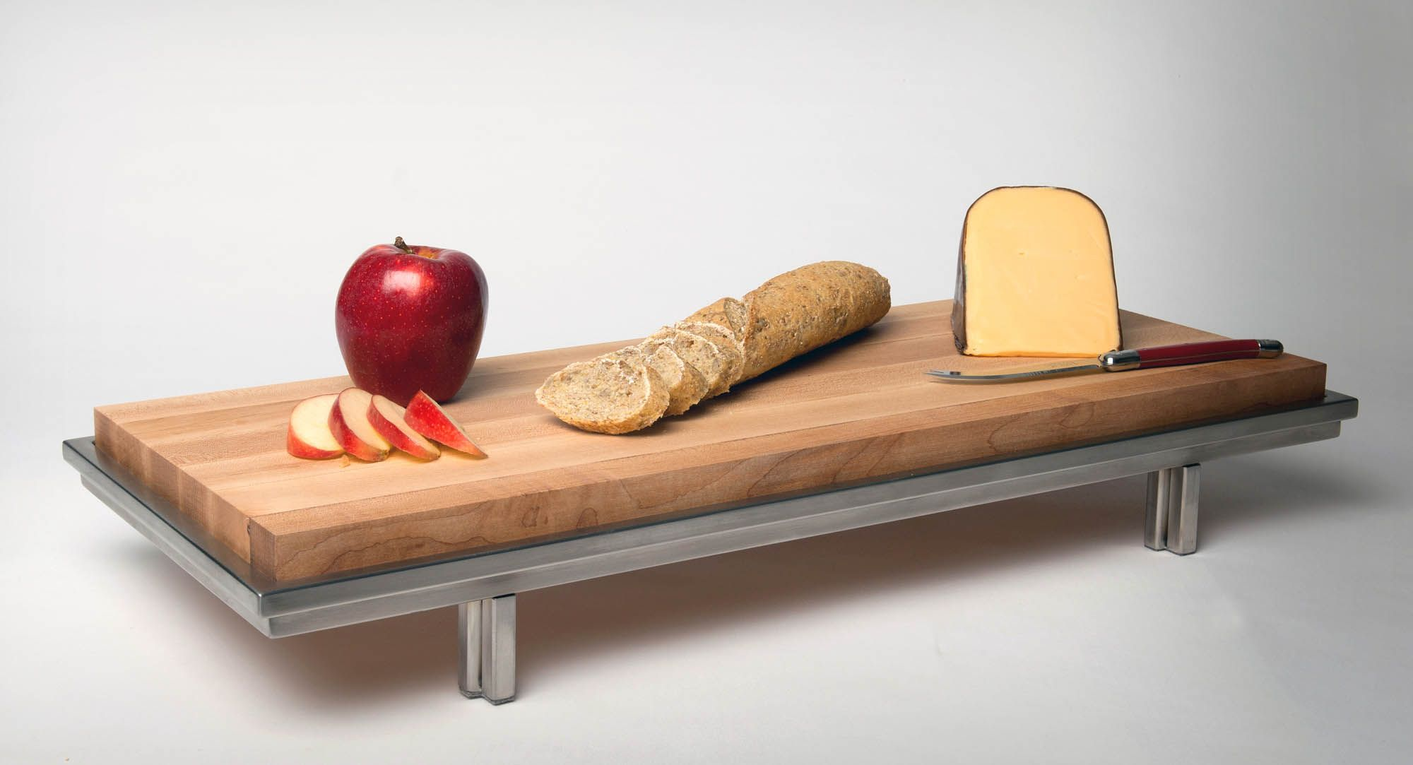 We provide the frames and you drop in a surface of your own choosing that best complements your kitchen aesthetic. We also offer maple cutting board inserts manufactured by the Michigan Maple Block Company for our trays.