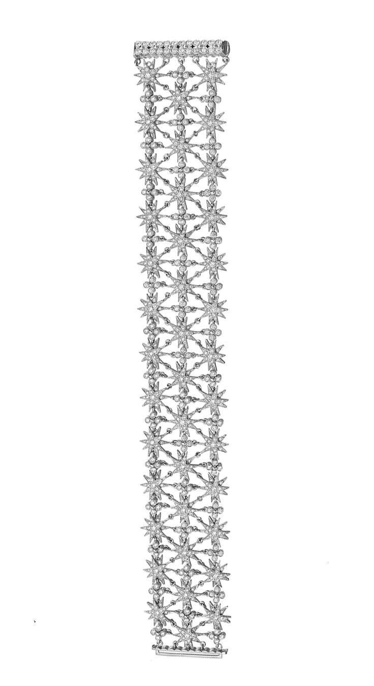 "Tiffany & Co. 3-Row Diamond Starburst Bracelet. 3-row diamond-set starburst wide bracelet with bezel-set diamond quatrefoil accents, set with round diamonds weighing approximately 6.02 total carats, mounted in platinum, signed Tiffany & Co. 7.25"" length and 1.10"" width at widest point. Accompanied by the Tiffany bracelet box."