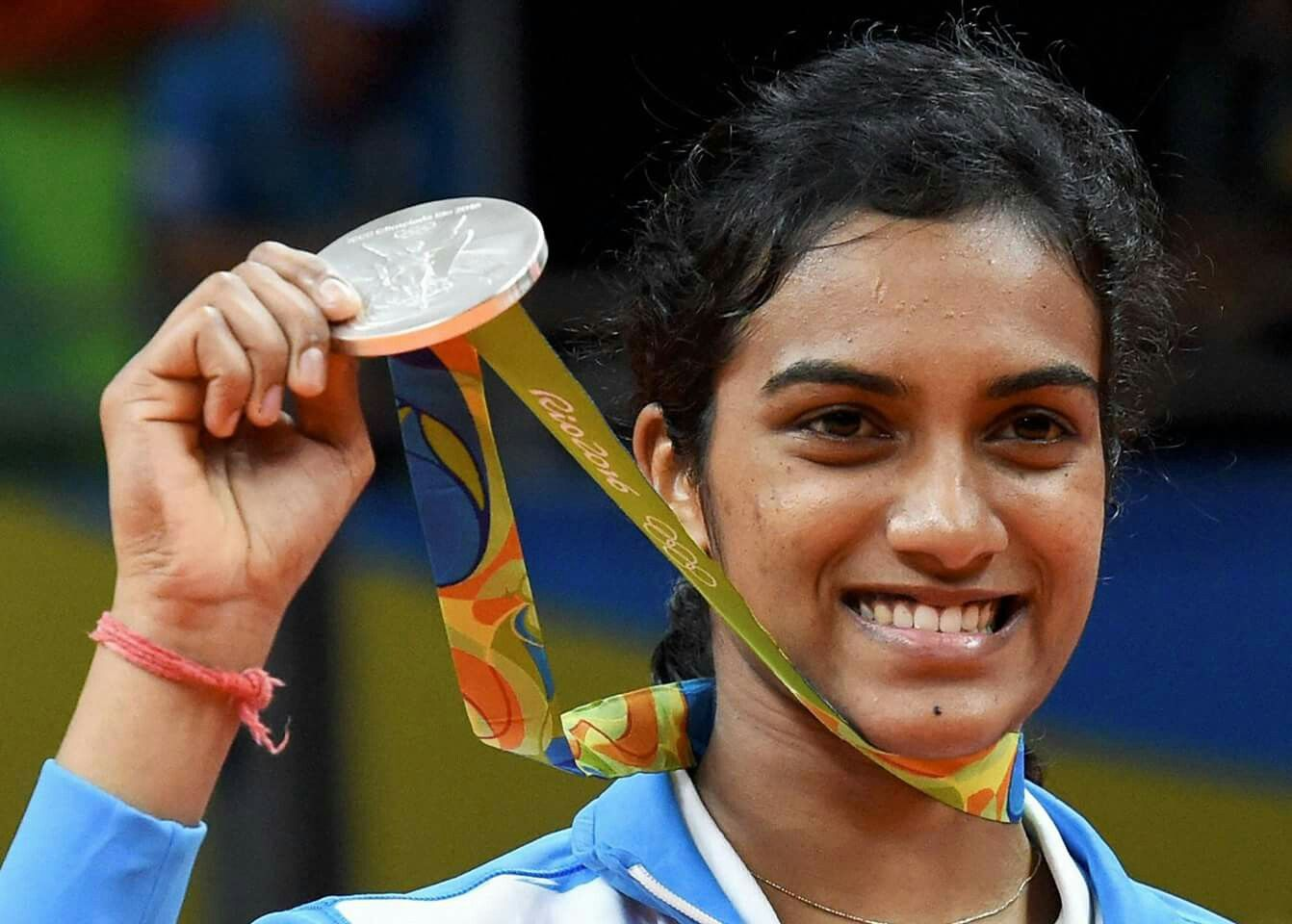 Rio2016 P V Sindhu poses with her silver medal at 2016 Summer