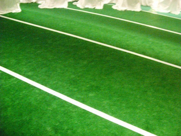 Football field, indoor/outdoor carpet & strip it w/ tape & cut the ...