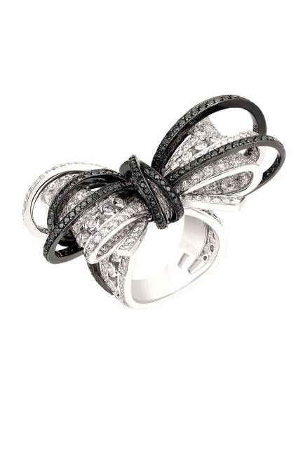 The 1932 Collection  Couture ring in 18K white gold, set with 265 brilliant-cut white diamonds, four baguette-cut white diamonds, and 175 brilliant-cut black diamonds.