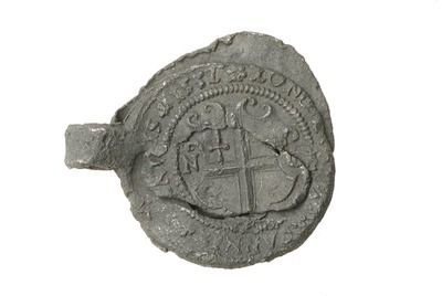 Lead cloth seal--This 'alnage' seal is from London  It has the arms