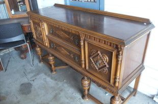 English Inlay Buffet  Beautiful overcarved buffet. Has excellent grain, inlay, and detail. Would work well in a Victorian home.  Item # 3820-2