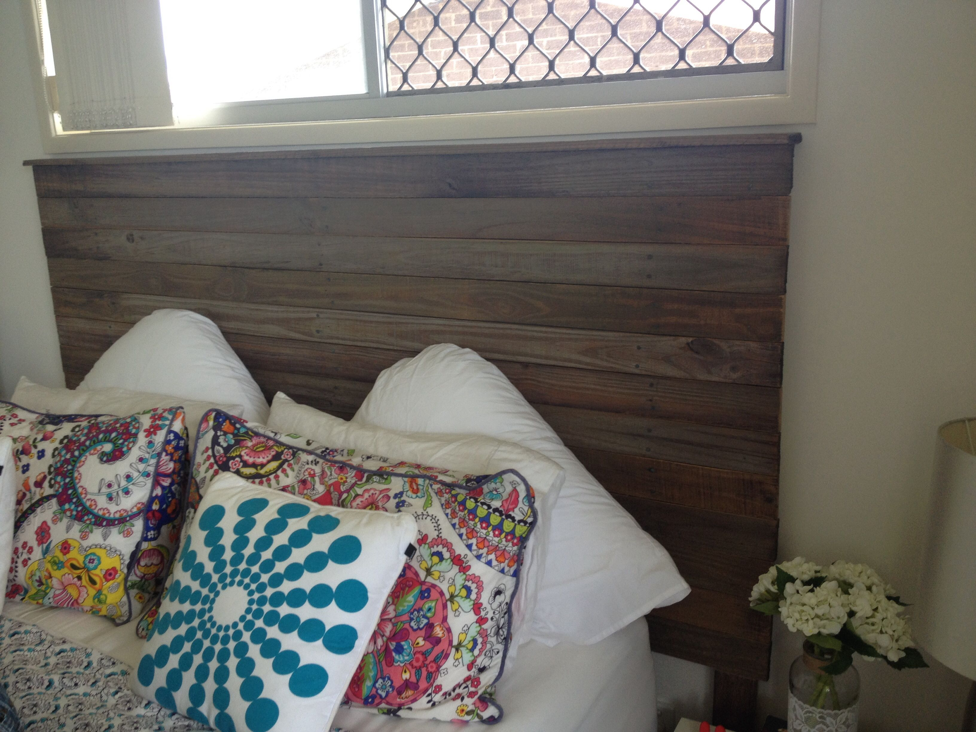 DIY bed board bed head . Made from salvaged fence palings