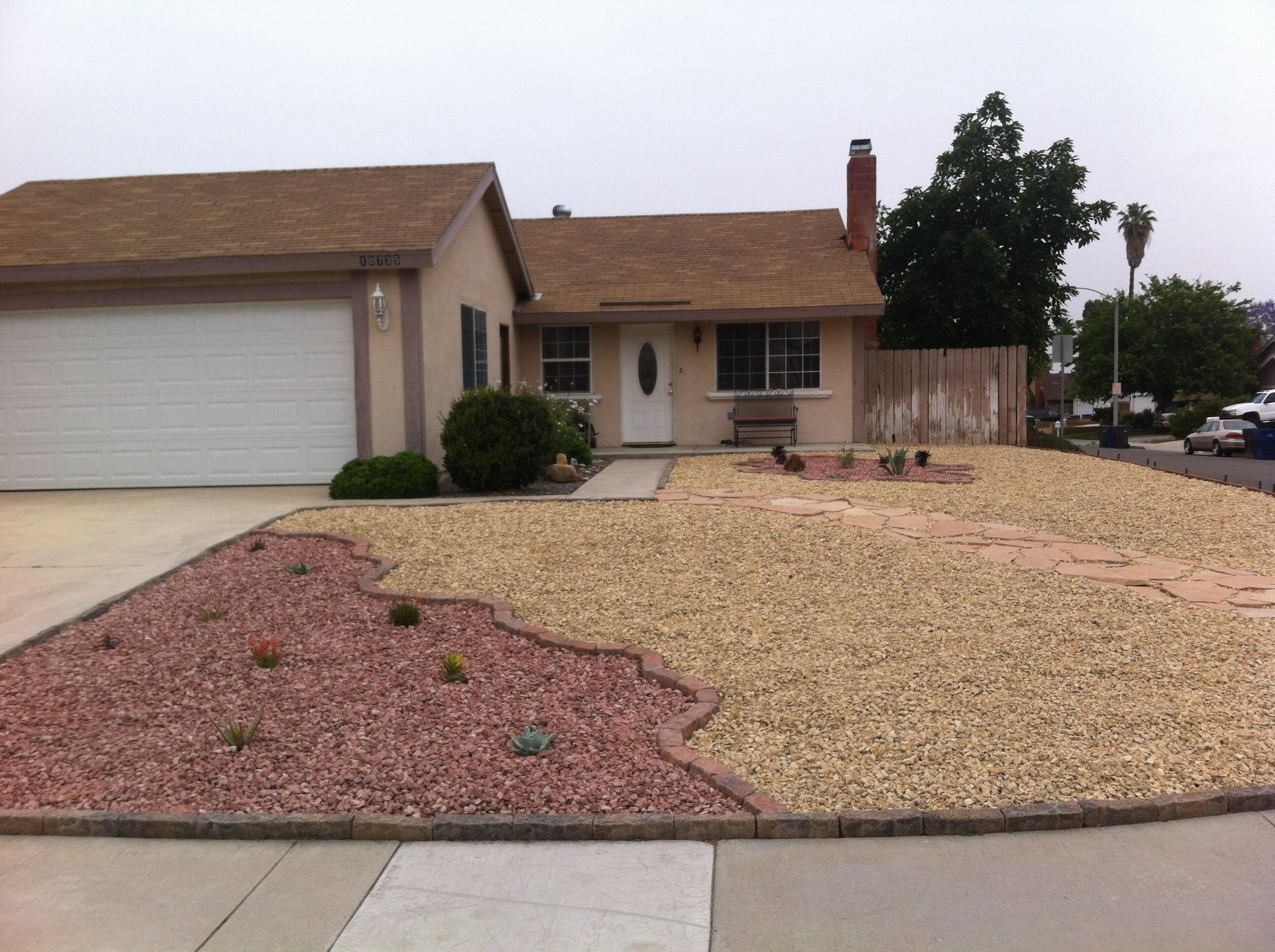 Desert scape front yard with drought tolerant plants and rock ...